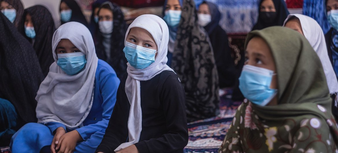 Afghan families receive COVID-19 prevention advice in Herat, on 2 September 2021.