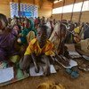 Children from the Central African Republic attend class in a protected space at a refugee camp in the Cameroon.