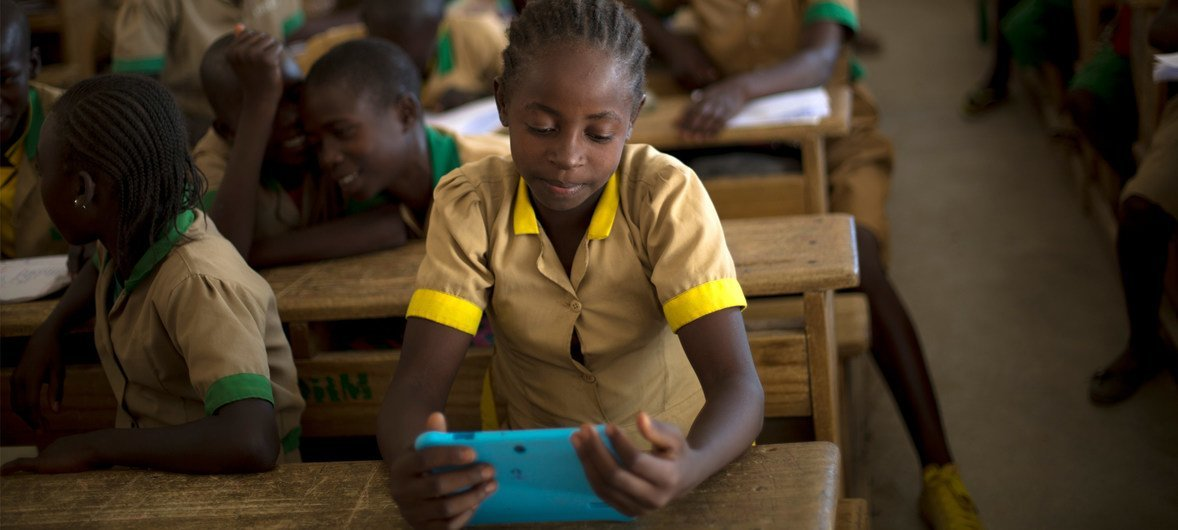 A student learns with the help of a computer tablet provided by UNICEF at a school in Cameroon (file)