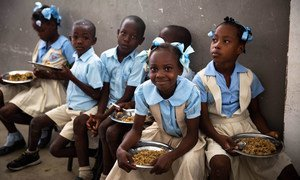 Children at a school in Haiti enjoy food provided as part of WFP's school canteen programme.