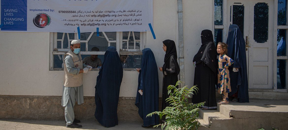 Women impacted by the COVID-19 pandemic wait to receive cash assistance from the World Food Programme in Kabul, Afghanistan.