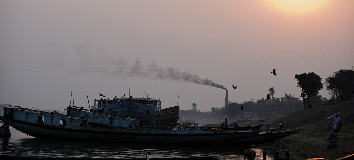 Countries must urgently transition away from fossil fuels. Pictured here, black smoke smoke rises from a chimney at a brick kiln, which uses coal fire to bake bricks, in eastern Bangladesh. (file photo)