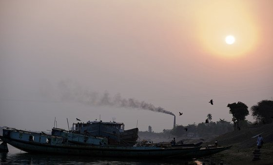 Black smoke rises from a chimney at a brick kiln, which uses coal fire to bake bricks, in eastern Bangladesh.