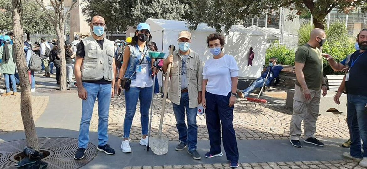 From left to right, photographer Fouad Fouani, Nadine Abi Zeid Daou, Mounir Tabet and Najat Rochdi have joined in the task of removing debris from the streets in Beirut.
