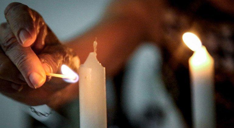 Freddy Glatt performs the Hadlakat Nerot, the Jewish ritual of lighting candles at dusk.