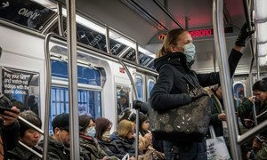 More New Yorkers appear to be wearing face masks as a precaution against the coronavirus.