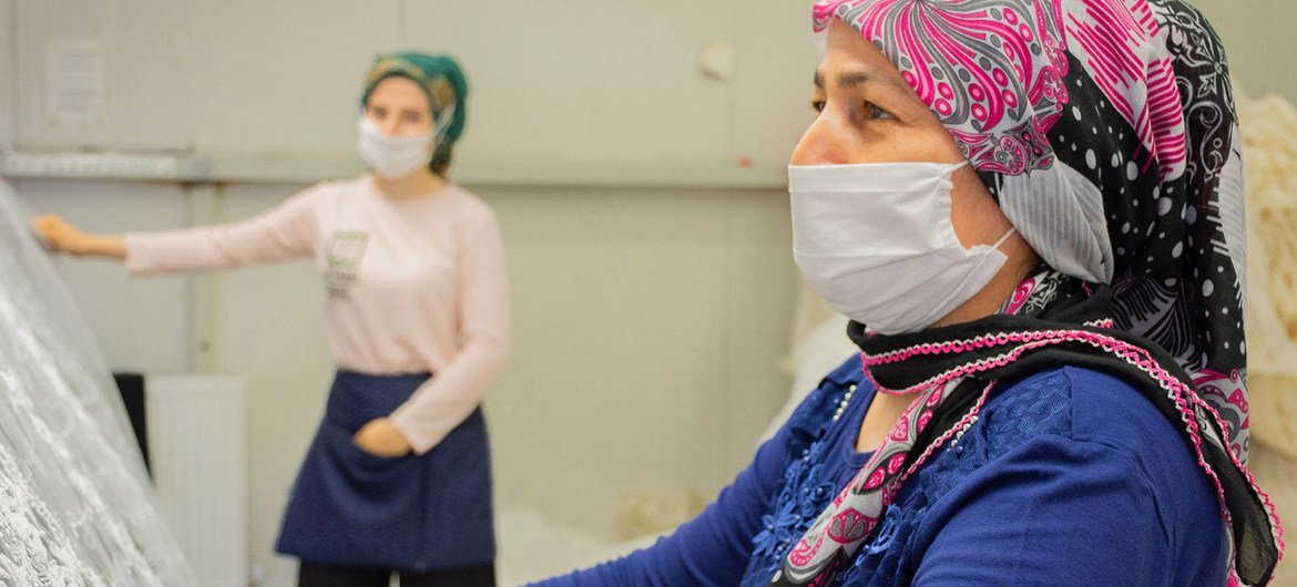 Women textile workers perform quality control tests at a factoy in Izmir, Turkey.