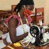 A woman in Guinea turns her sewing skills into mask-making during the COVID-19 crisis.