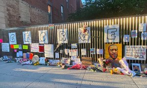 An impromptu memorial for George Floyd, who was killed after being restrained by police, has been set up in Harlem, New York City.