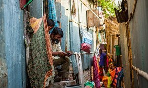 As unparalleled economic shock puts development gains at risk, community workers in Bangladesh distribute hygiene packages and promote coronavirus prevention awareness.