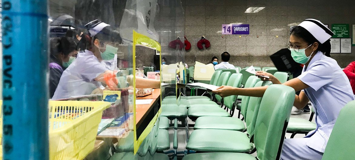 Seating arrangements and acrylic shields have been installed to ensure social distancing at a hospital in Bangkok, Thailand.
