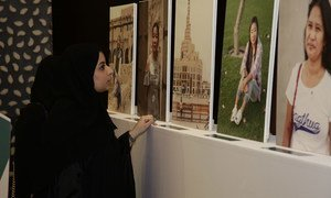 A woman views an exhibition of portraits of domestic workers on their day off on International Domestic Workers Day in Qatar.
