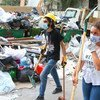 Community supporters clean up the aftermath of the catastrophic explosion in the area of Gemmayze, in Beirut, Lebanon.