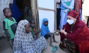 UN Deputy Secretary-General Amina Mohammed meets a young girl in Borno state in northeastern Nigeria.