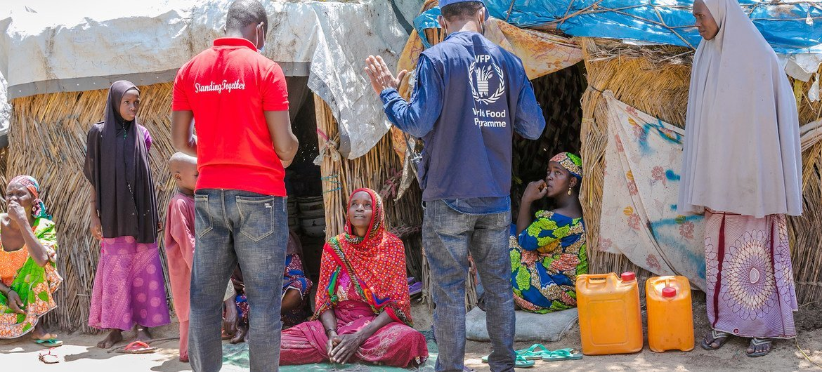 COVID-19 is undermining nutrition among the world's most vulnerable people, particularly children, pregnant and breastfeeding mothers. Pictured here, a WFP staff member interviews displaced persons at an informal IDP settlement in Maiduguri, Nigeria.