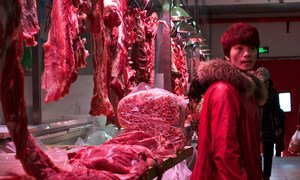 A meat stall in a market in Beijing, China.