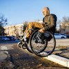 It takes Dmitry Kuzuk, an activist for persons with disabilities, a lot of skill and effort to navigate through city streets in his wheelchair.