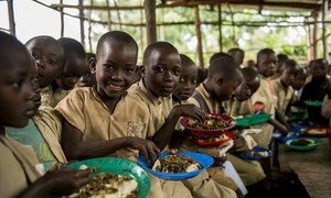 Children eating lunch at a primary school in Burundi (file photo).