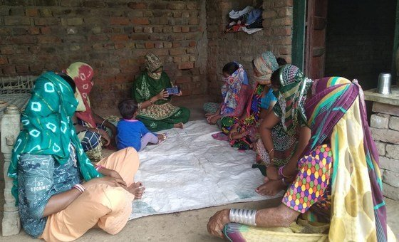 Self-employed rural Indian women learn how to carry out basic online transactions.