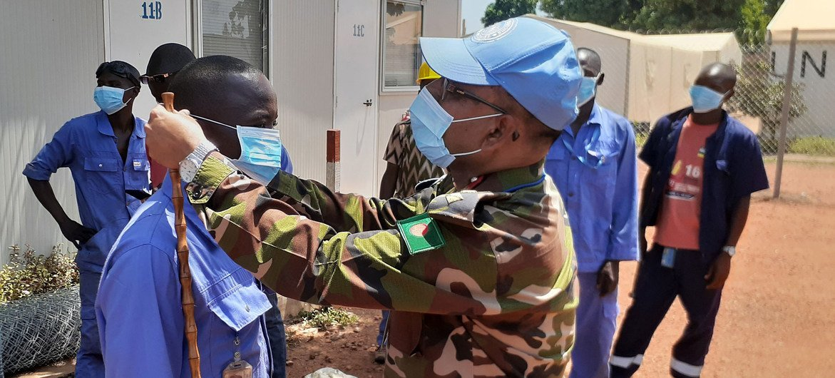As part of the information campaign on COVID-19, the commander of the Bangladeshi medical contingent at the UN peacekeeping mission in the Central African Republic, encourages local contractors to wear protection masks.
