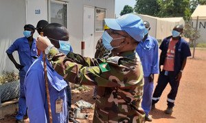 As part of the information campaign on COVID-19, the commander of the Bangladeshi medical contingent at the Security Council-mandated UN peacekeeping mission in the Central African Republic, encourages local contractors to wear protection masks.