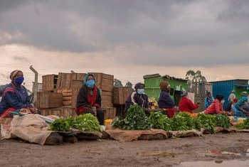 Kenyan market vendors practice social distancing to prevent the spread of COVID-19.