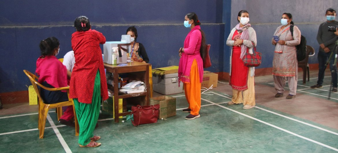 Healthworkers and frontliners in Gorkha District in north-central Nepal receive their second dose of the COVID-19 vaccine.