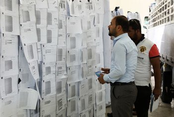 Manual recount of votes from 2018 national election, Baghdad International Fair, Iraq. (file)