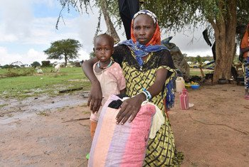 Sudanese refugees flee across the border to escape Darfur violence. Twenty-three-year-old Sudanese refugee fled with her children to Kartafa in Chad in July 2020.