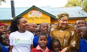 UN Deputy Secretary-General, Amina Mohammed (right) meets local school children at the Food4Education innovative partnership in Nairobi, Kenya.