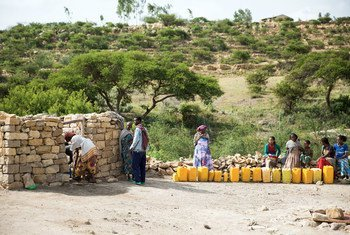 Families fetch water from a UNICEF supported well in Kilte Awlalo in the Tigray region of Ethiopia.