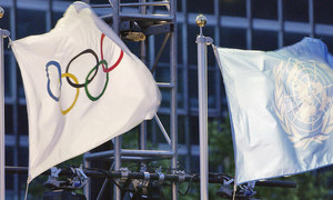 The UN and the Olympic flags are raised at headquarters shortly before the torch ceremony.