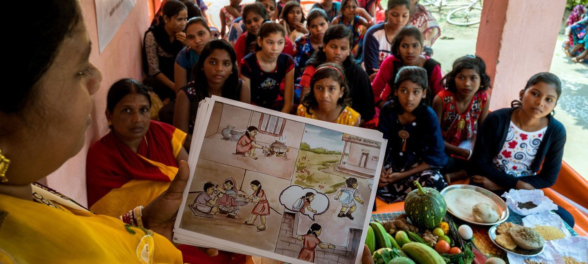 Adolescents in India meet once a month, where they learn about nutrition, including the need to eat food in the three colours of the national flag – orange, white and green.