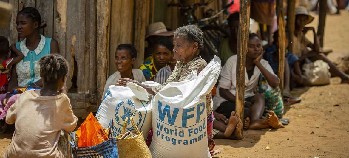 Residents in the drought affected communities of Ifotaka, southern Madagascar, collect  food assistance provided by the UN World Food Progamme.