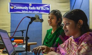 In Teknaf, Bangladesh, presenter Joya Pul Happy (left) and her producer Shanta Pul at the community radio, work on an upcoming show. (August 2018)