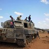 Children play on an abandoned tank in Libya. (File)