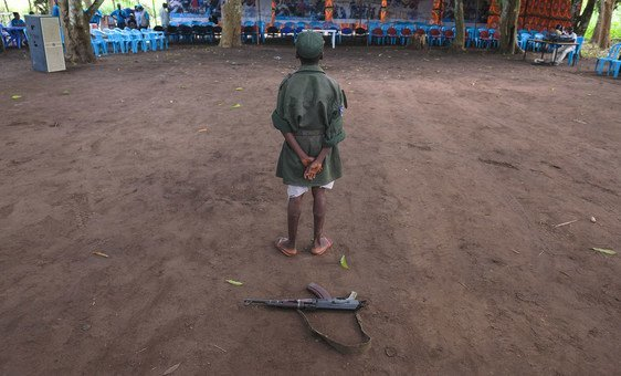 A child stands during a ceremony to release children from the ranks of armed groups and start a process of reintegration in Yambio, South Sudan.
