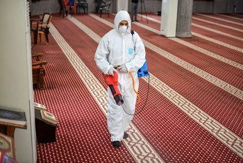 A mosque  in Gaza is cleaned to prevent the spread of COVID-19.