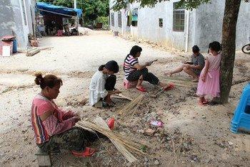 """2019年,联合国粮农组织、广发证券与中华农业科教基金会共同启动""""联合国可持续发展目标示范村""""项目,旨在通过""""互联网+农业+金融""""的模式,推动中国乡村振兴战略实施,助力实现可持续发展目标。图为该项目在海南省白沙县的示范村之一。"""