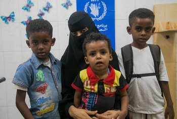 A mother brings her children for nutrition checks at a WFP-supported clinic in Aden, Yemen.
