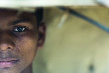 A boy who was forced to work in a factory in Hyderabad, India is pictured outside his home.