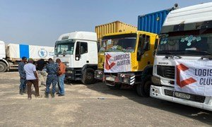 Humanitarian aid being delivered to the Tigray region of Ethiopia by a convoy of 50 trucks .