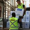 Workers unload WFP food aid at the Karageusian Center in Beirut, Lebanon.