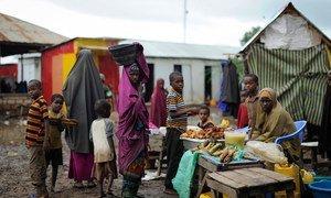 Women and children at a market stand in Kurtunwaarey , Somalia.