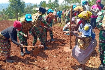 Peacekeepers celebrate International Day of Peace in a village in South Kivu, Democratic Republic of the Congo.