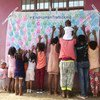 Refugee children show their support for a UN refugee agency anti-trafficking campaign at Wad Sharife camp in east Sudan.