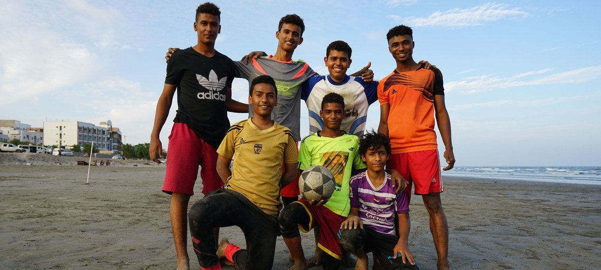 Local Yemeni boys pose for a photo before playing football on the beach in Aden. (November 2018)