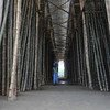 A worker walks through a bamboo drying station in Cox's Bazar, Bangladesh.