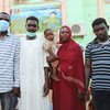 Relatives wait outside a hospital in Kassala, Sudan, where their 28-year-old sister is being treated for dengue fever. Like many Sudanese, due to the economic crisis, they struggle to pay for the treatment.