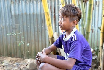 13-year-old San Min Htet scavenges for scraps of jade stone in northern Myanmar.